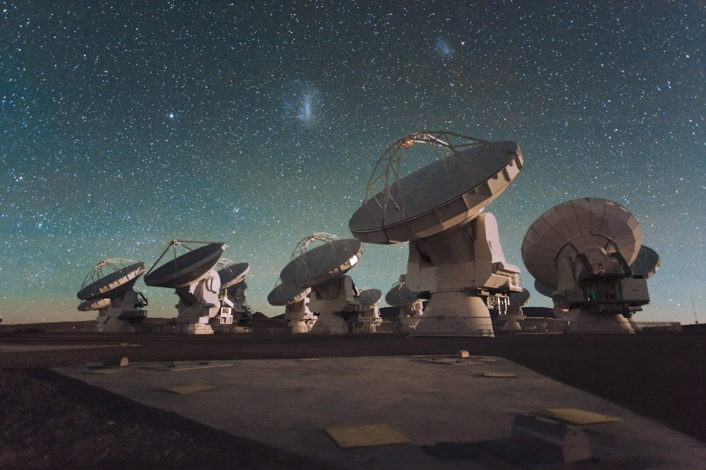 The Atacama Large Millimeter Array ALMA by night under the Magellanic Clouds