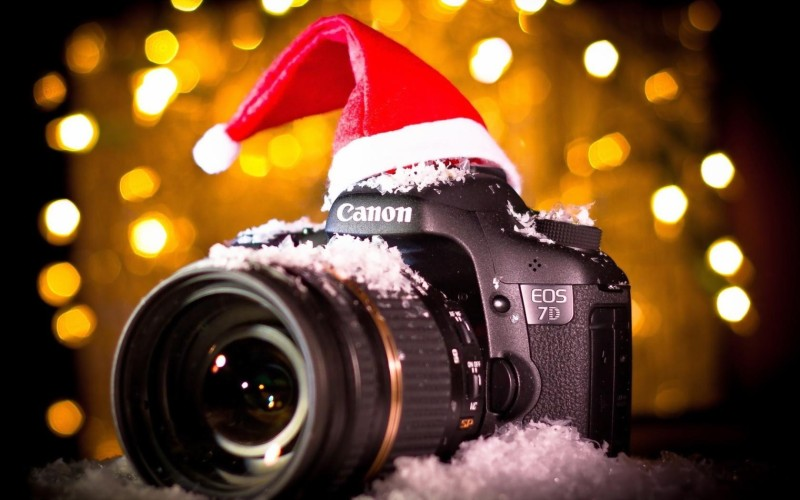 camera canon winter snow lights christmas photo wallpaper 1680x1050