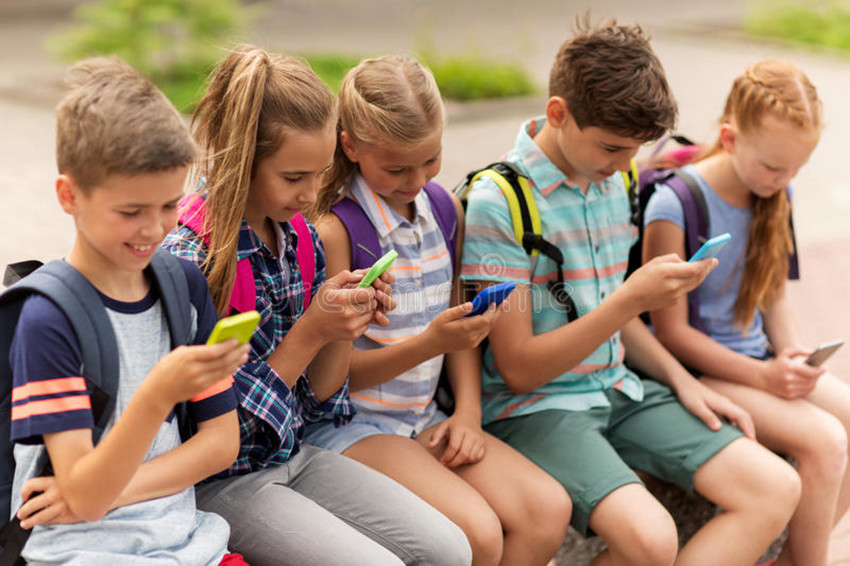 elementary school students smartphones primary education friendship childhood technology people concept group happy 79979807